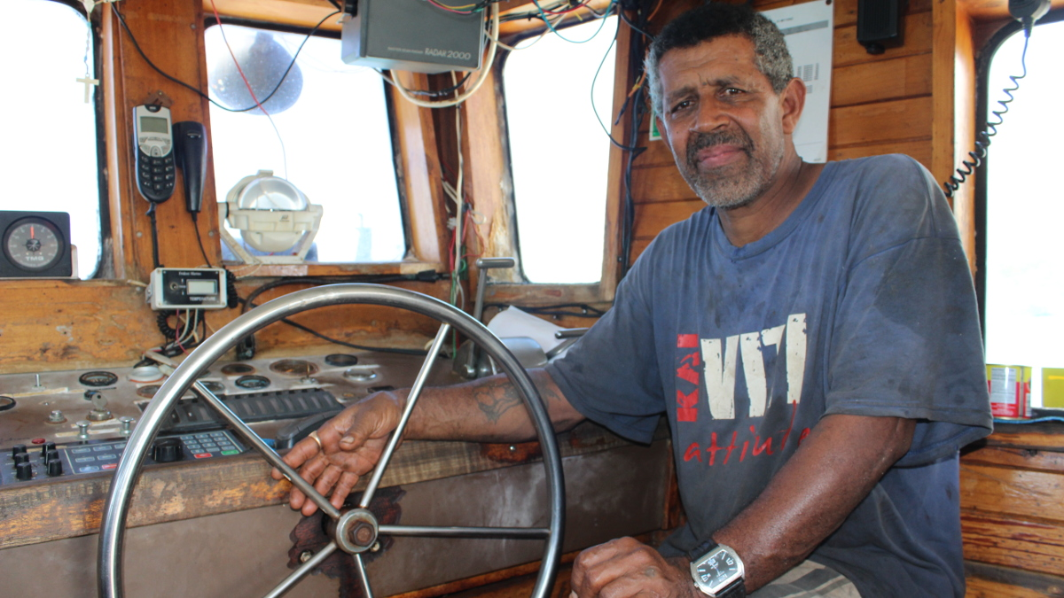 Fishing boat captain in Rarotonga, Cook Islands, assignment for Asian Development Bank